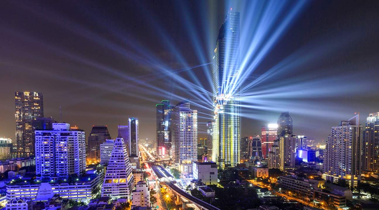 King Power MahaNakhon and the Bangkok cityscape lit up by nightlights in the evening